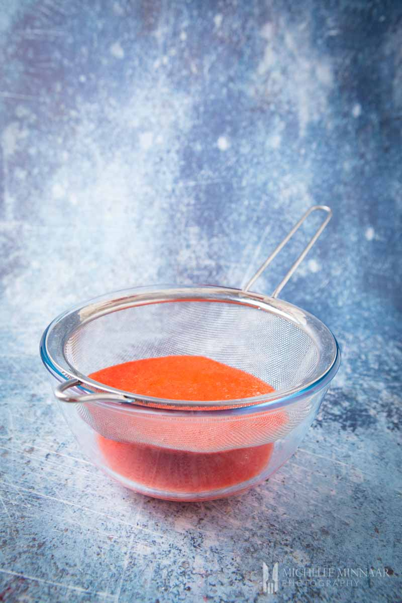 Red powder in a small dish