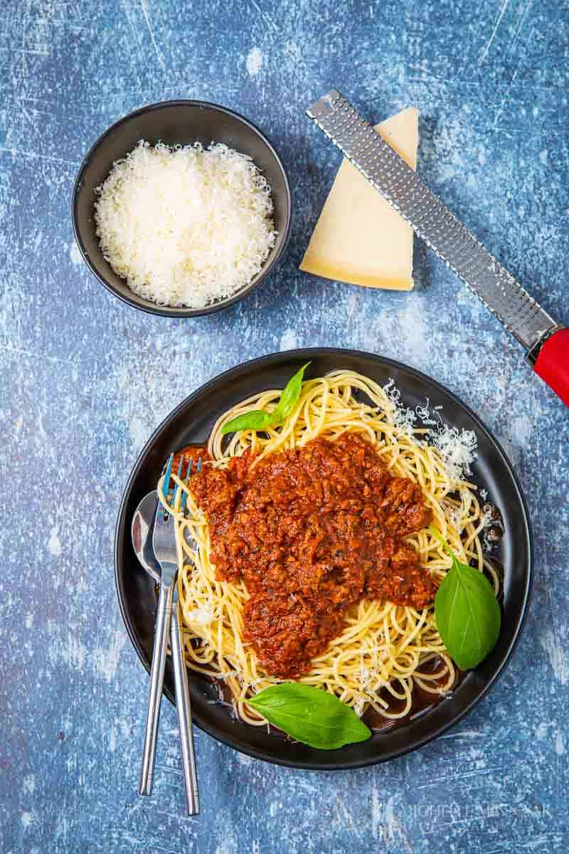 Plate of slimming world spaghetti bolognese and parm cheese
