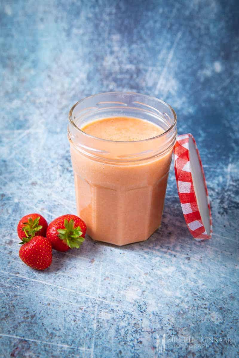 Clear Jar of strawberry curd