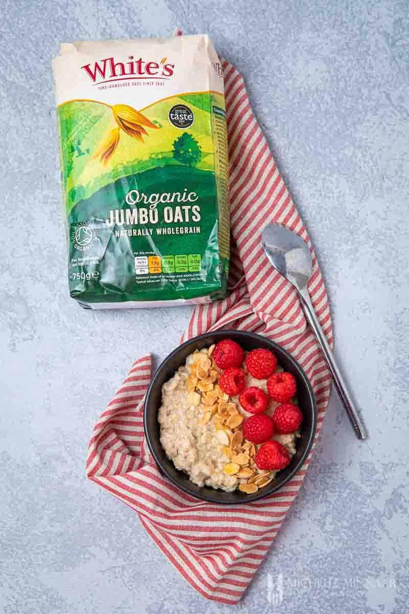 Bag of whites oats and a bowl of almond milk porridge