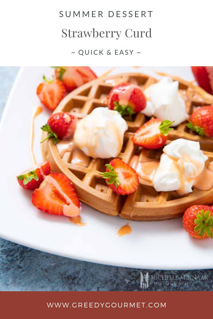 Waffle covered in strawberries and strawberry curd