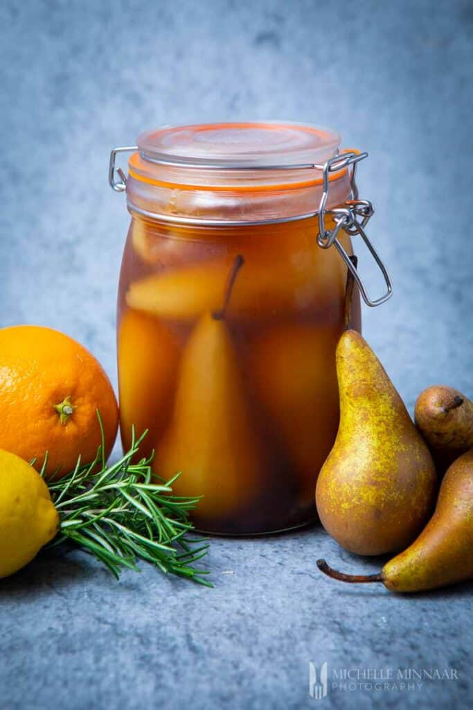 Jar of brown brandied pears and whole pears