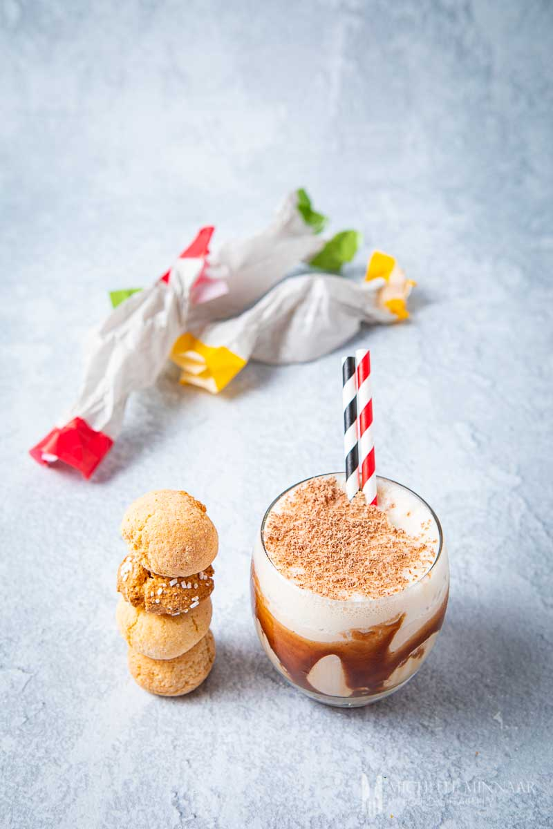 A glass of Toblerone cocktail with biscuits