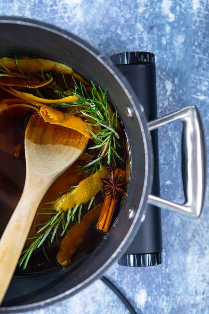 Sauce pan of liquid and rosemary