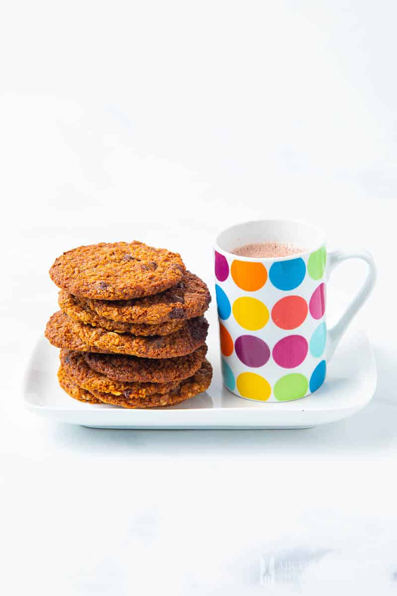 Stack of cookies and mug of milk