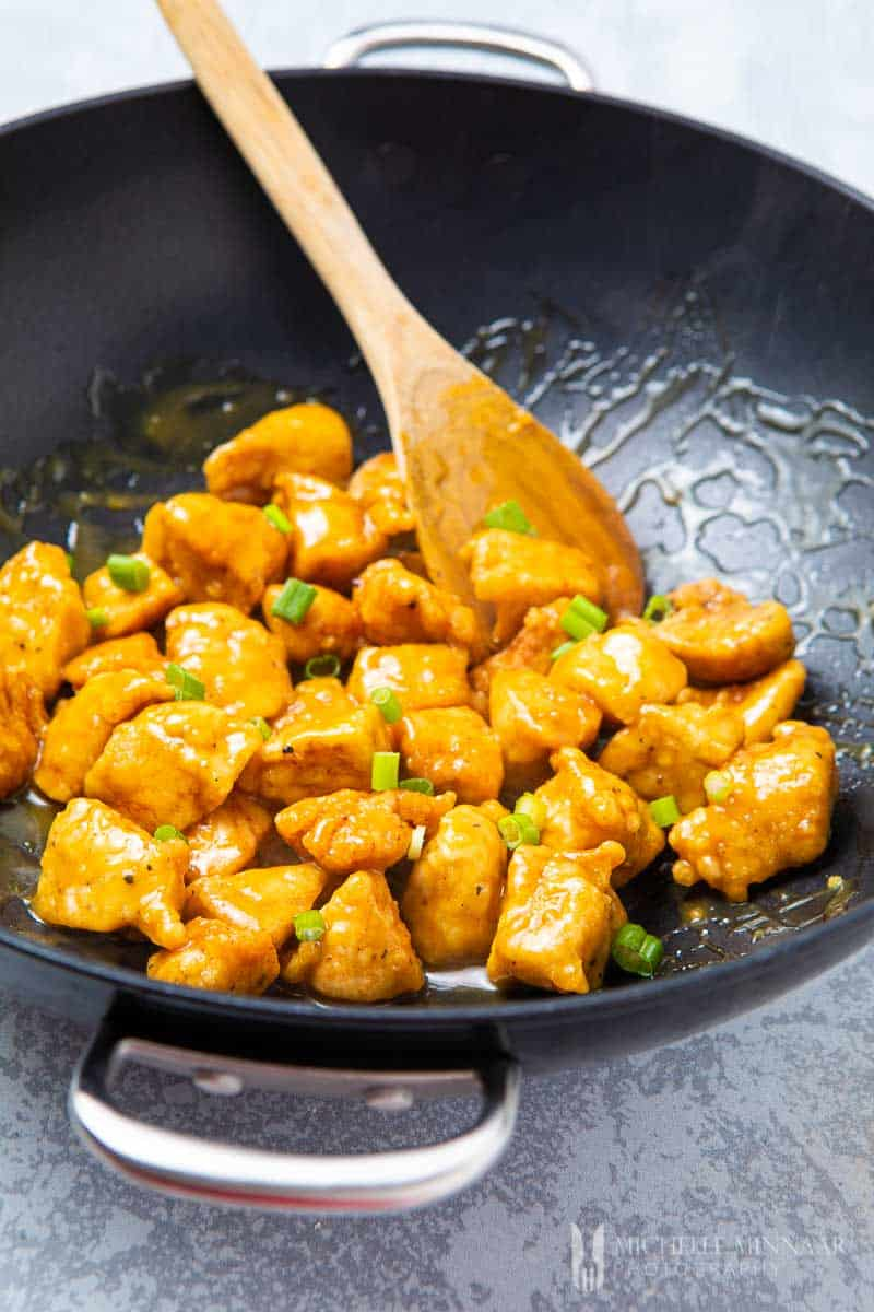 Close up of Orange peel chicken in a saute pan