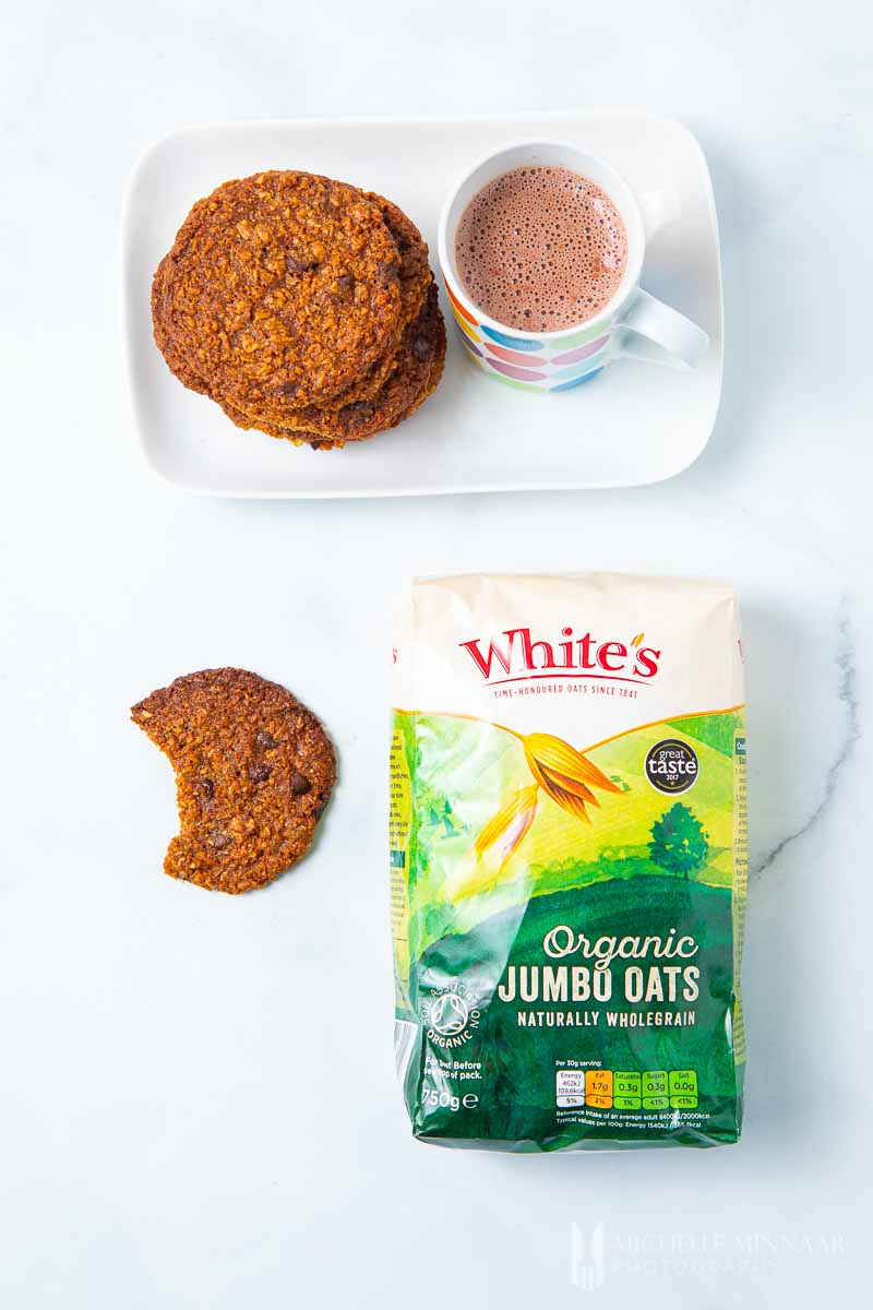 Plate of Vegan Oat Cookies and a bag of whites oats