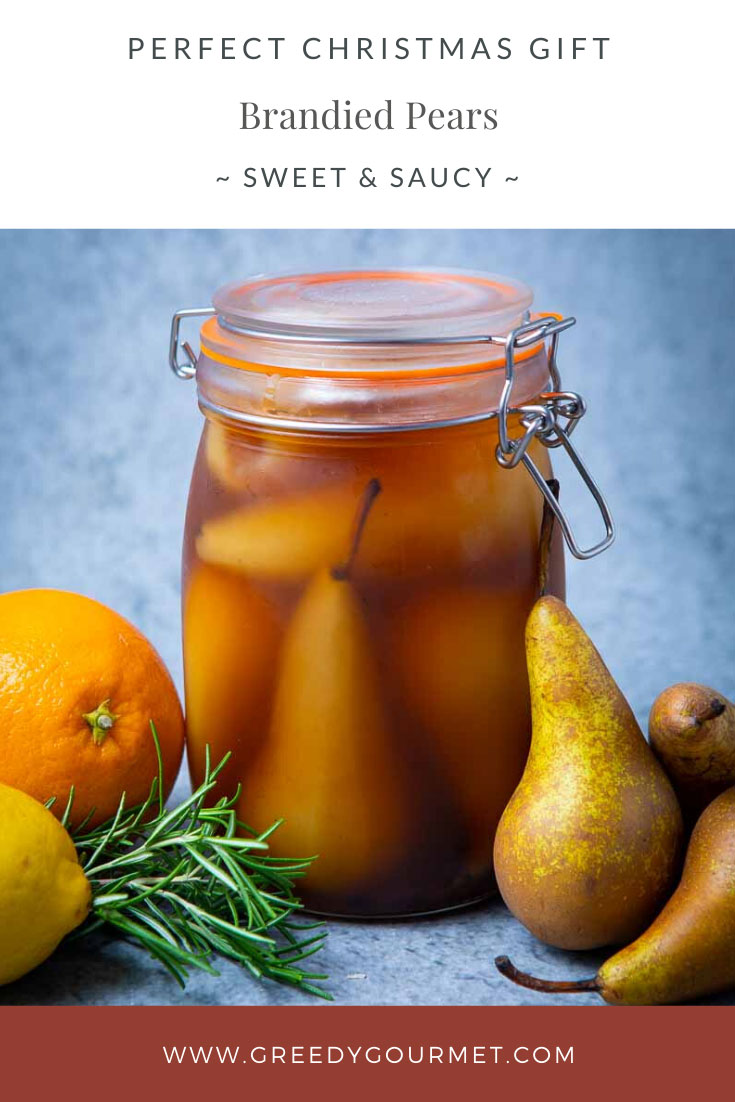 Clear jar of brandied pears