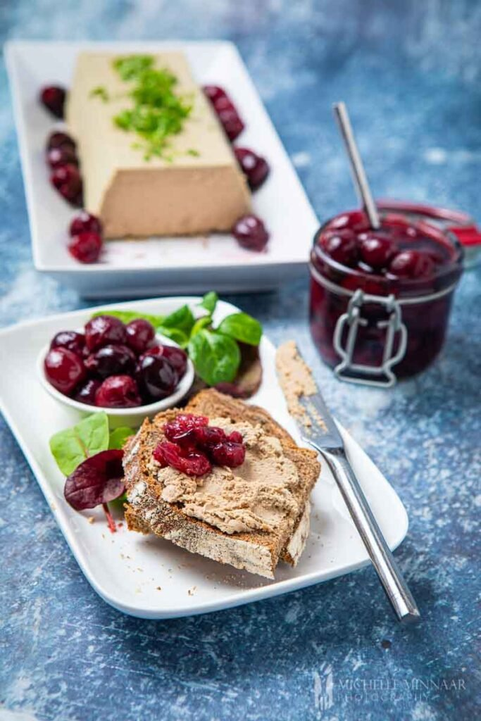Plate of brad and duck liver parfait and brandied cherries