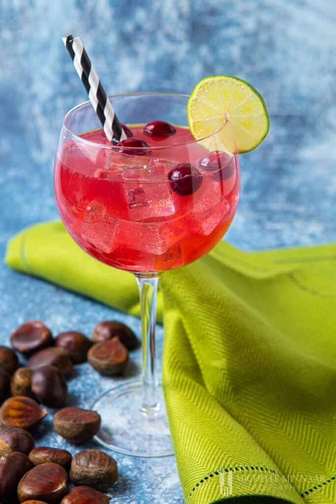Large red glass of Christmas gin cocktail