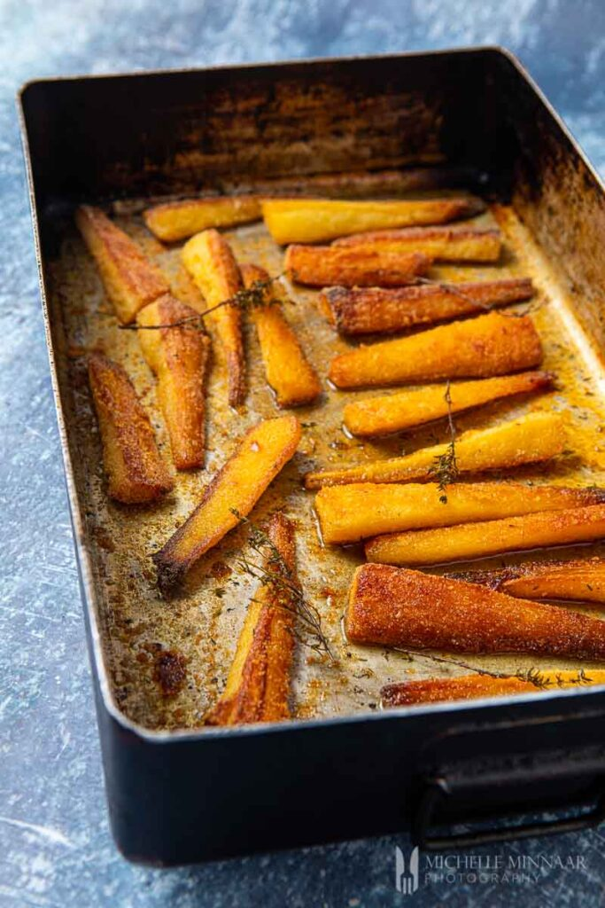 parmesan parsnips in a pan