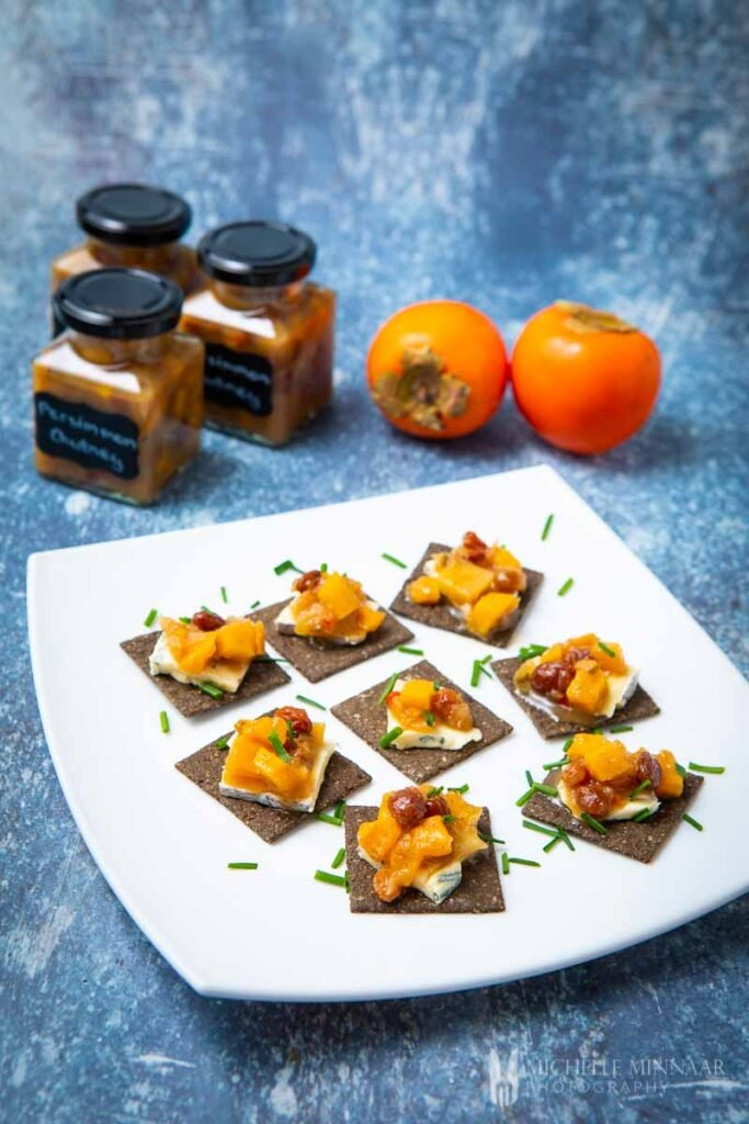Tapas of persimmon chutney on crackers