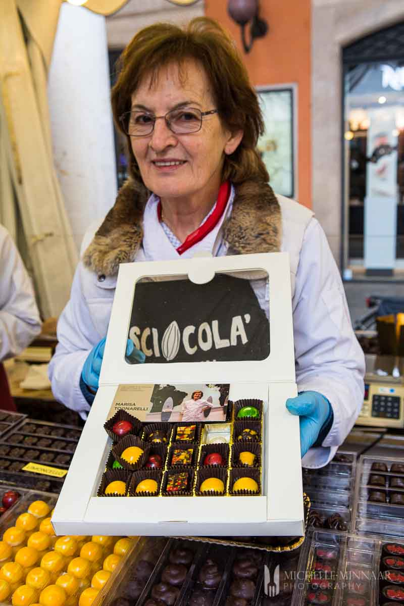 Lady holding box of chocolates at Sciocola chocolate event in Modena, Italy.