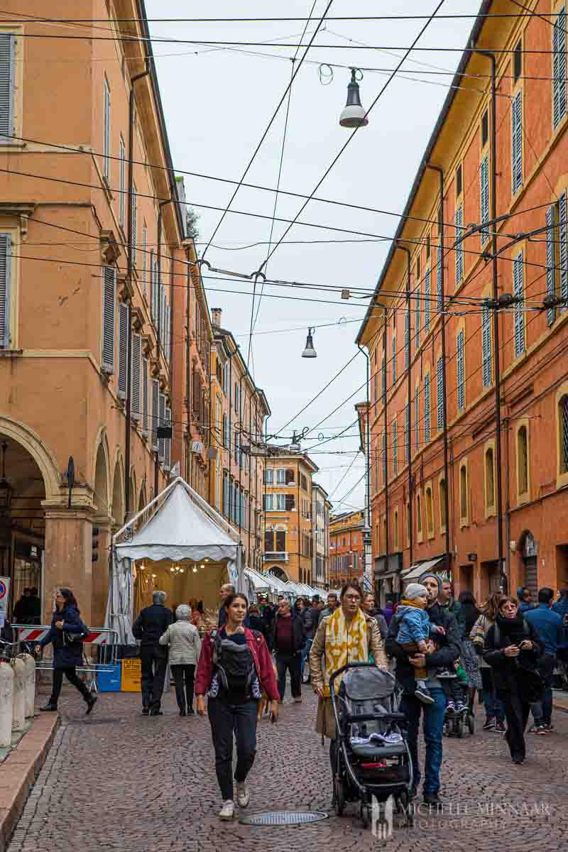 Families walking in the streets of Modena during chocolate festival.