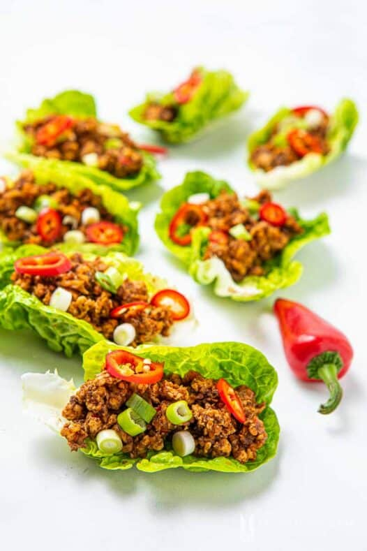 Close up of lettuce meat cups with red peppers as garnsih
