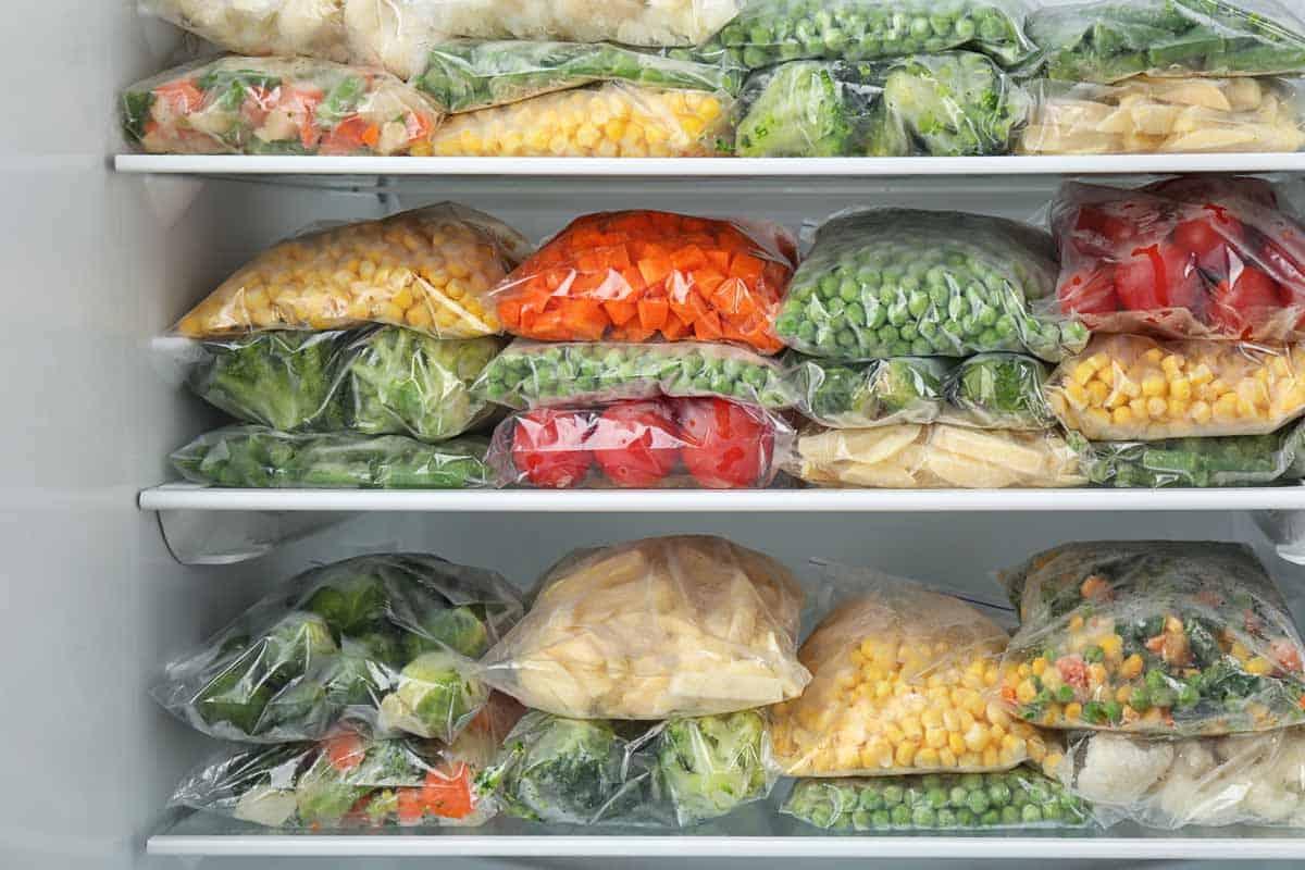 Bags of frozen vegetables in a freezer