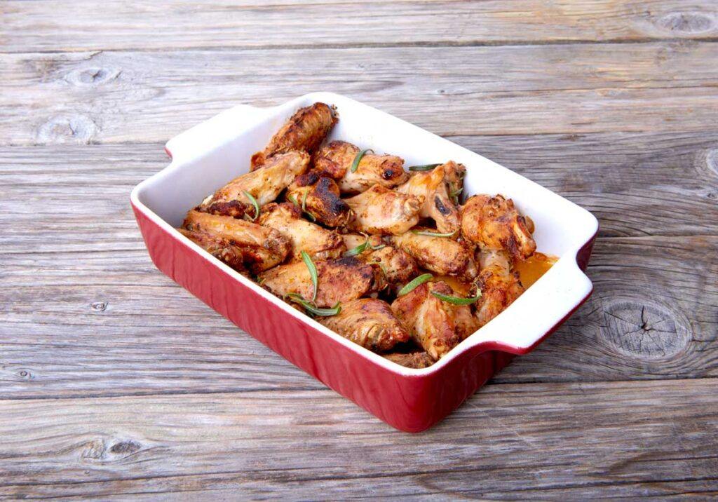 Chicken wings in bbq sauce in a casserole dish