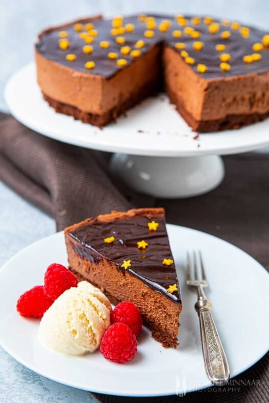 Full chocolate delice cake with a slice removed
