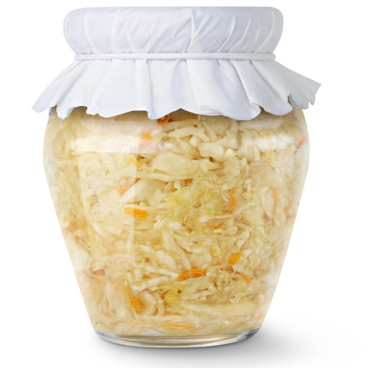 Glass sealed jar of pickled white cabbage