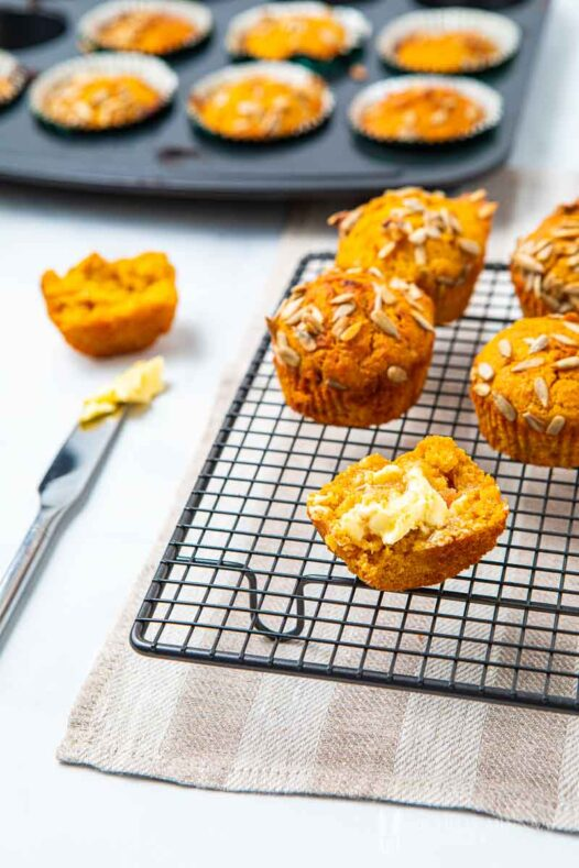 Muffin with butter on a rack