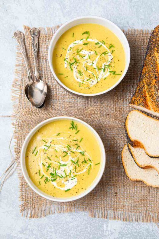 Two bowls of yellow leek and onion soup