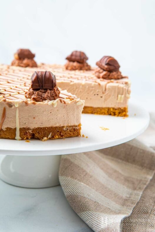 Full Kinder Bueno Cheesecake with a slice removed