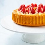 Whole side view of a strawberry flan cake