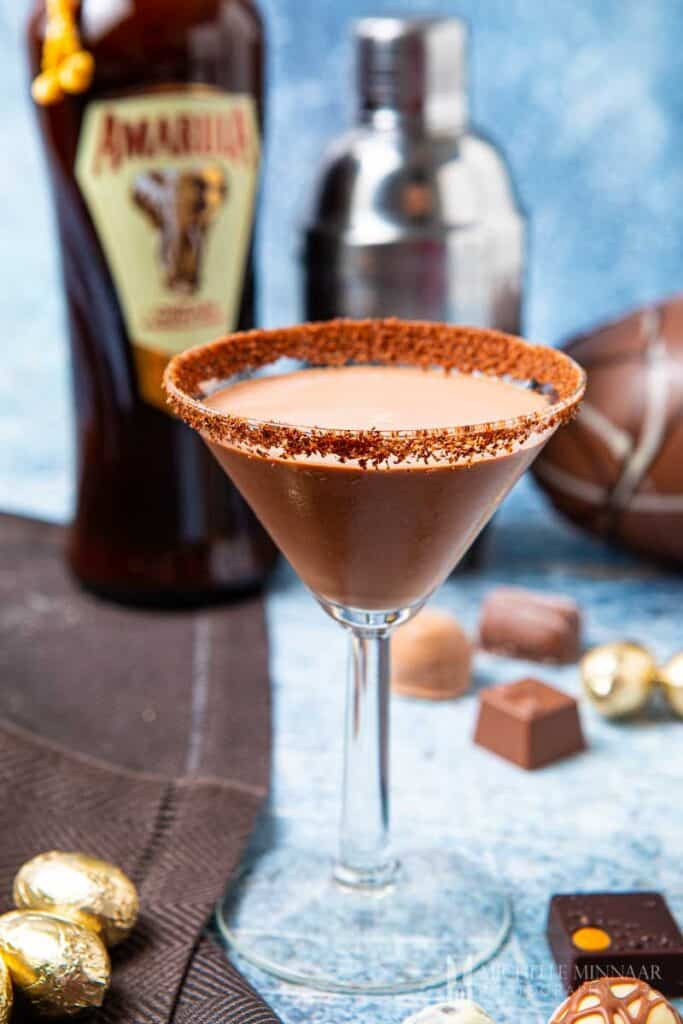 Martini glass rimmed with chocolate sugar and liquid amarula inside
