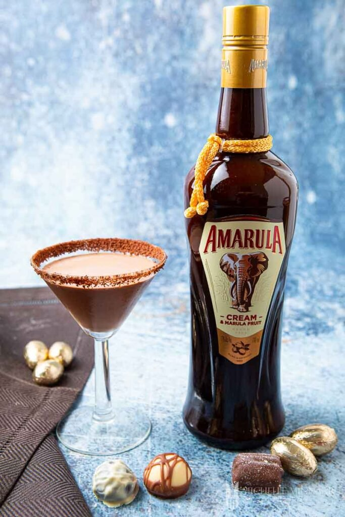 Glass of chocolate amarula cocktail and a bottle of amarula