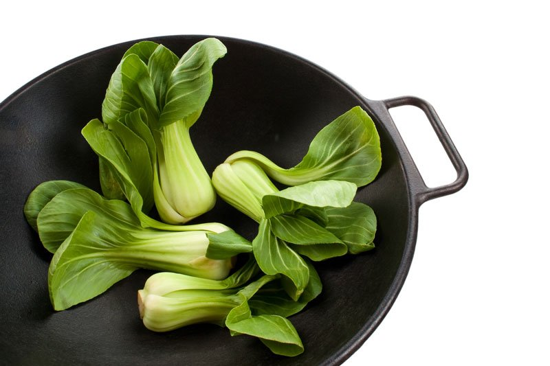 Green bok choy in a saute pan