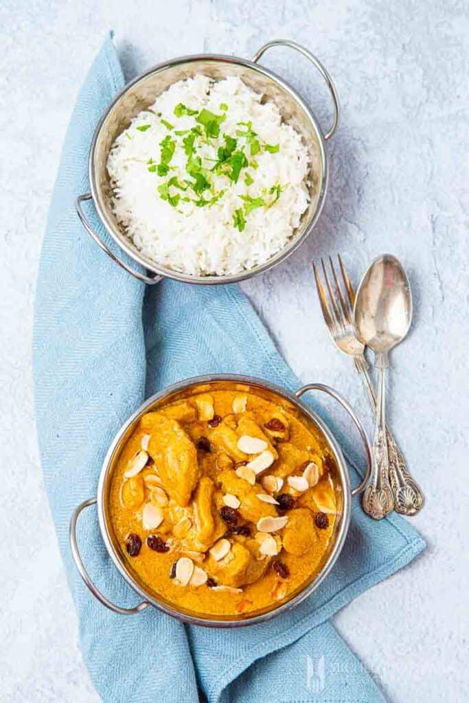 Bowl of chicken pasanda and white rice