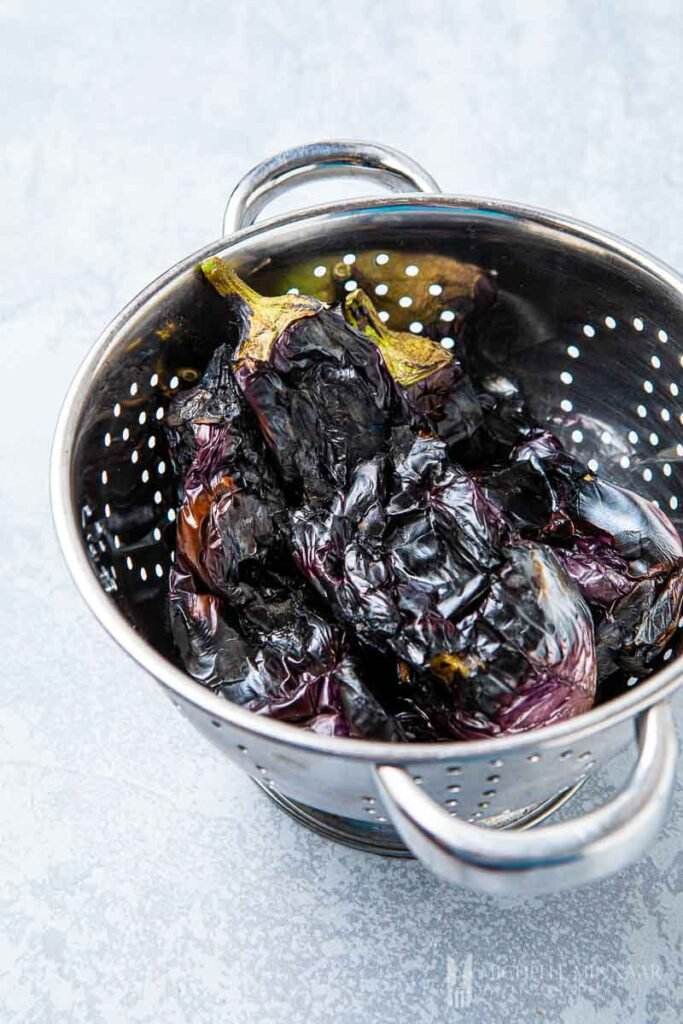 Grilled eggplant in a strainer