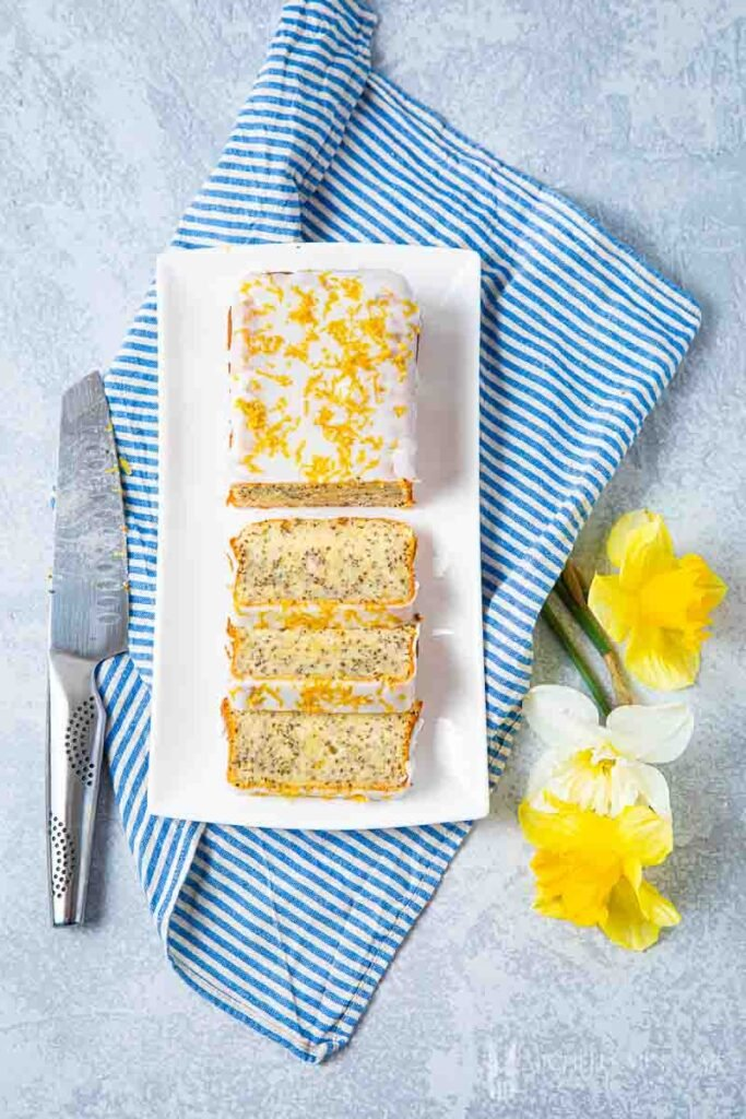 Sliced chia seed cake with yellow flowers
