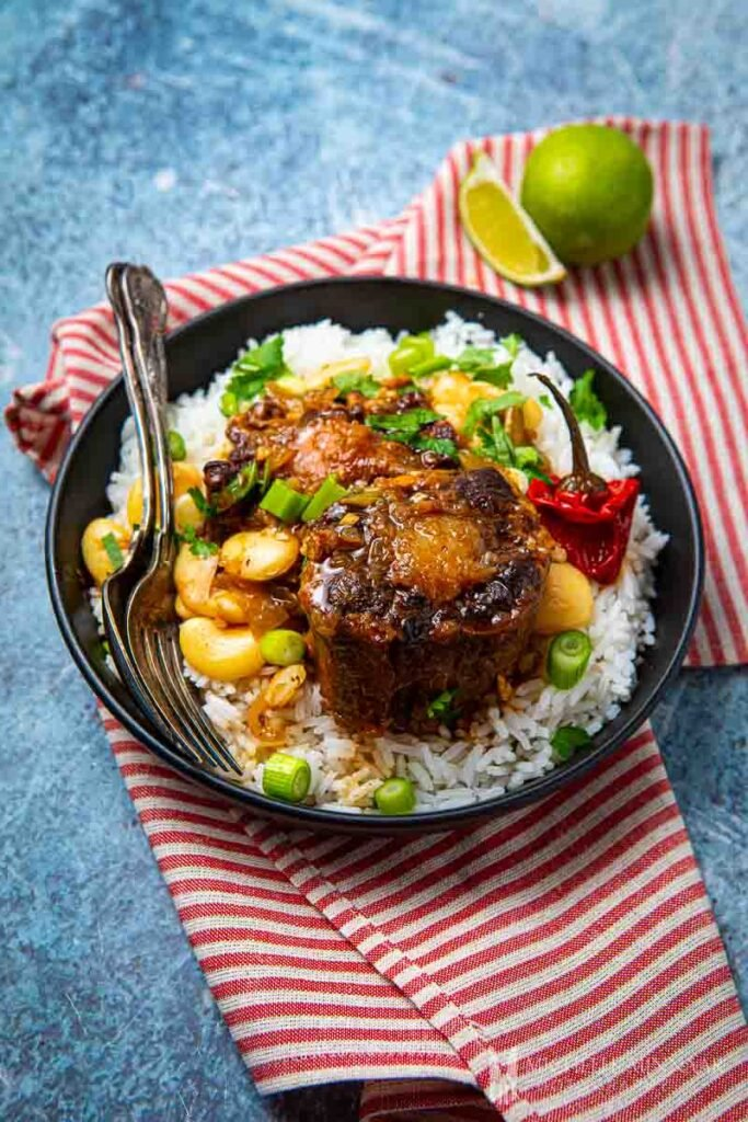 Full Carribean meal, oxtail over rice