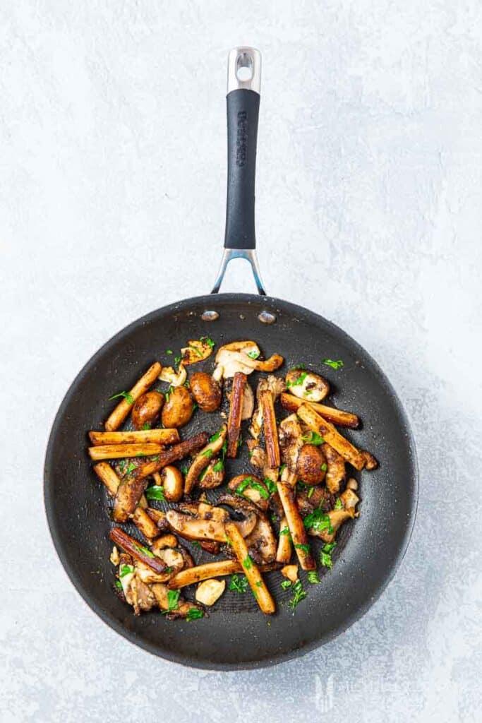 Mushrooms sauteing in a pan