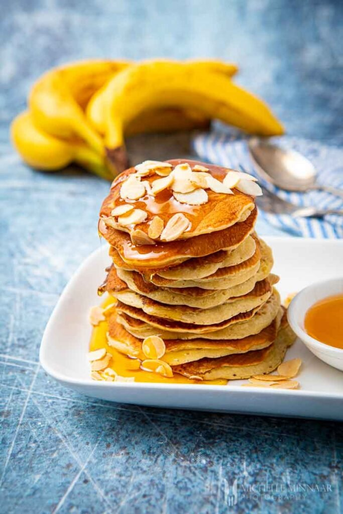 Pile of banana pikelets with syrup