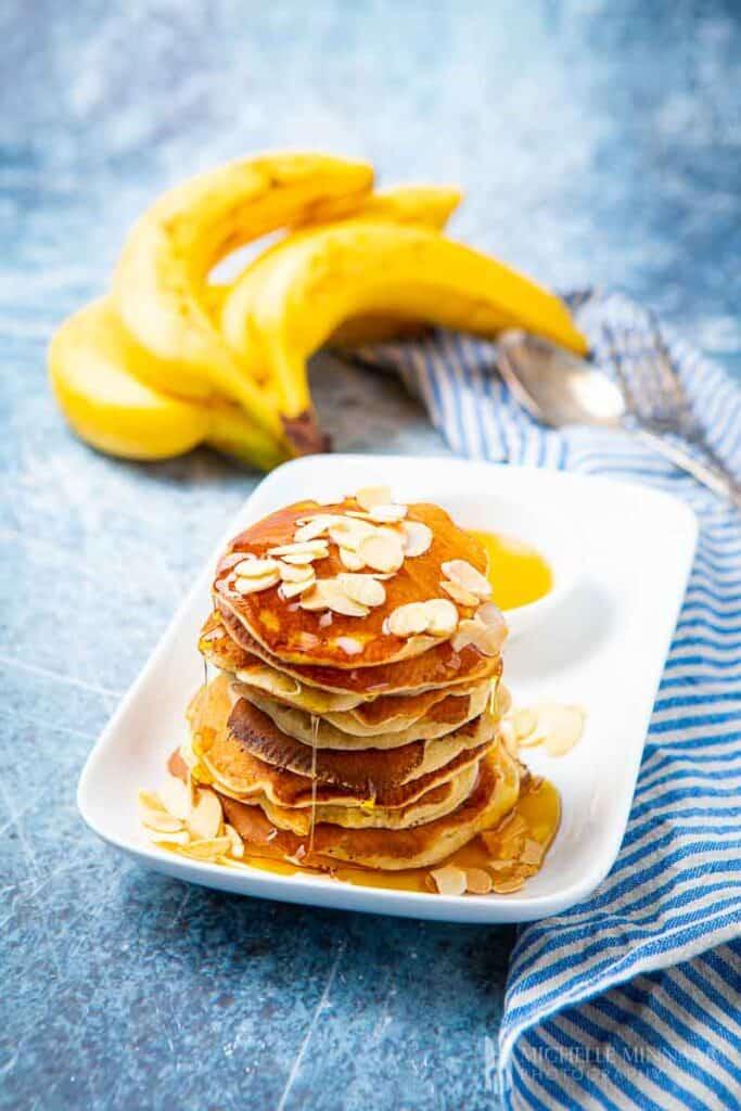 piled high pancakes with bananas