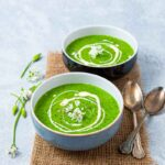 Two bowls of green wild garlic soup
