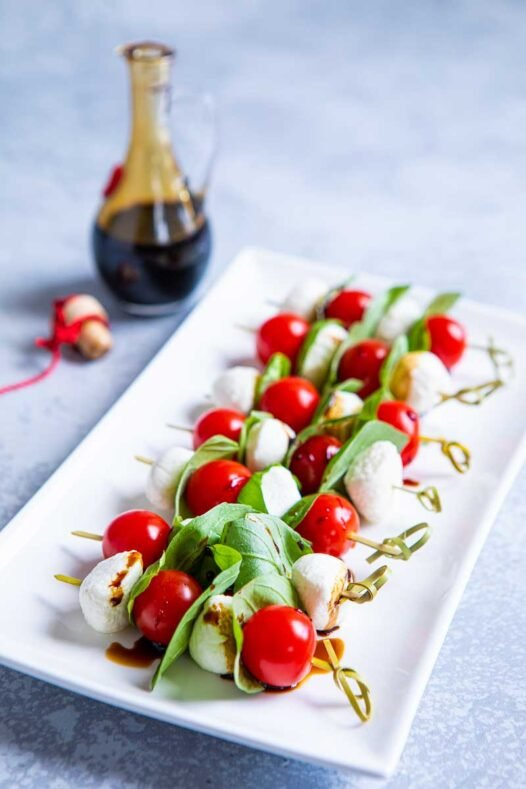 Plate full of caprese skewers recipe