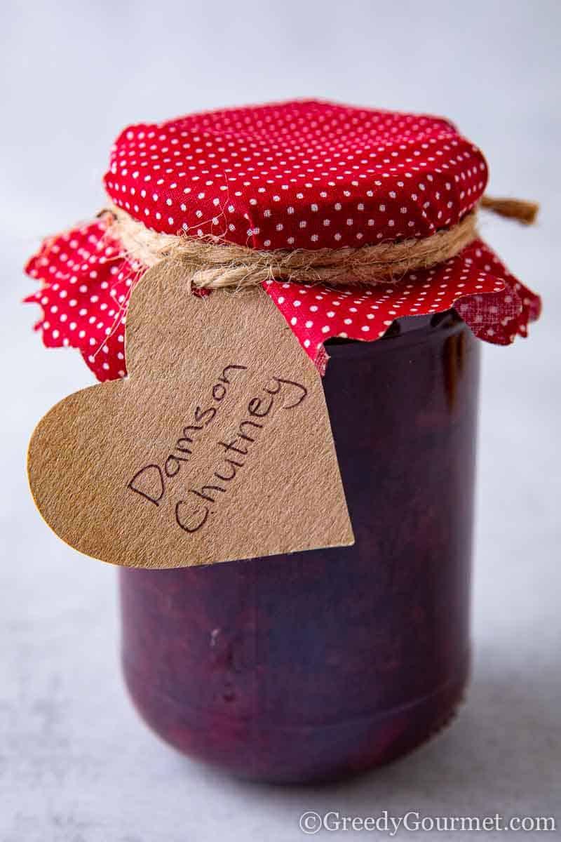 Jar of fresh jam to learn how to make a damson jam