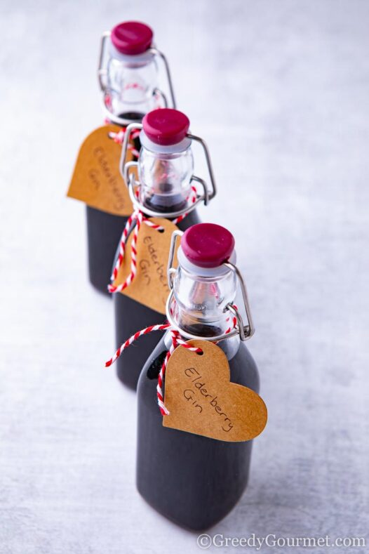 Three bottles of elderberry gin