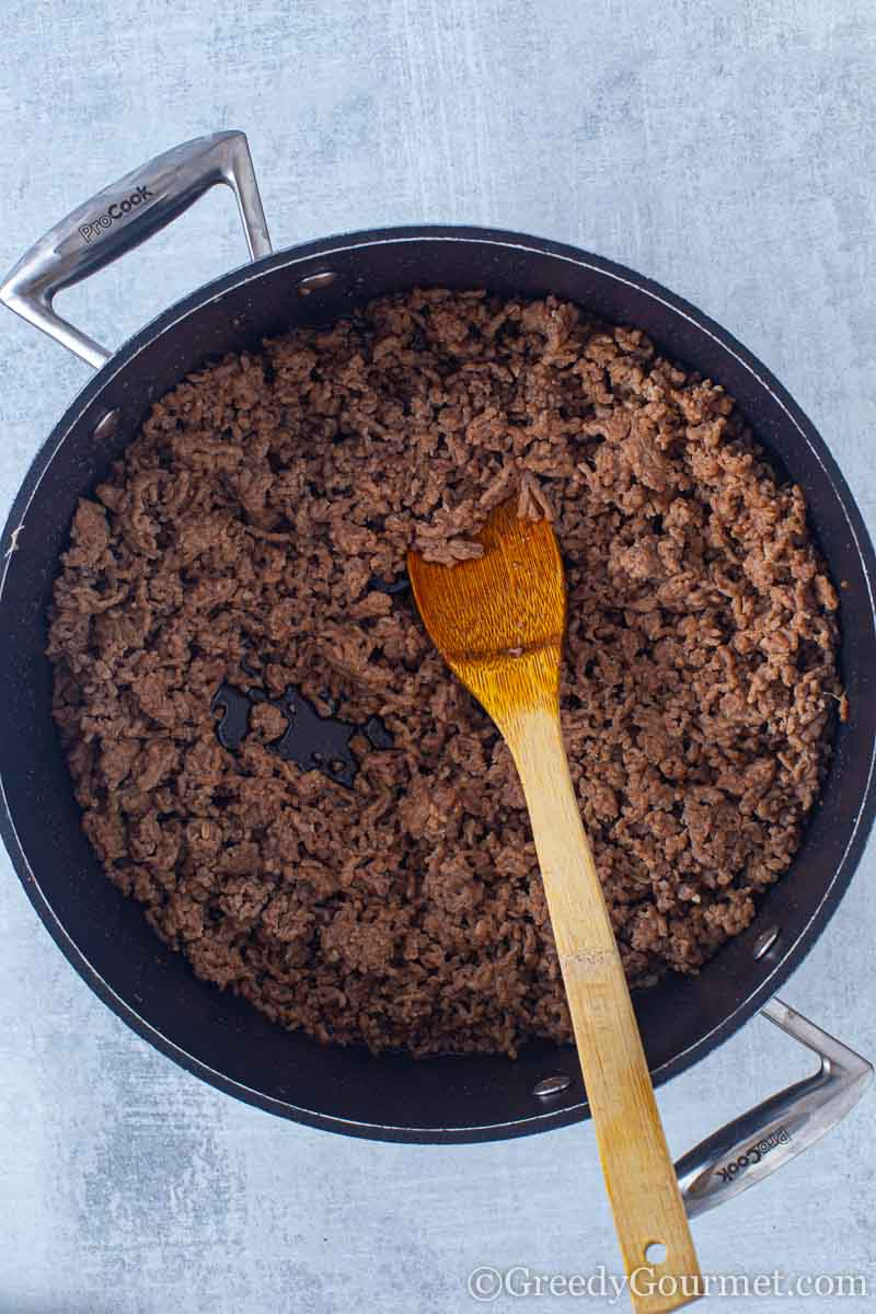 Meat browning in a pan to make a beef and potato recipe
