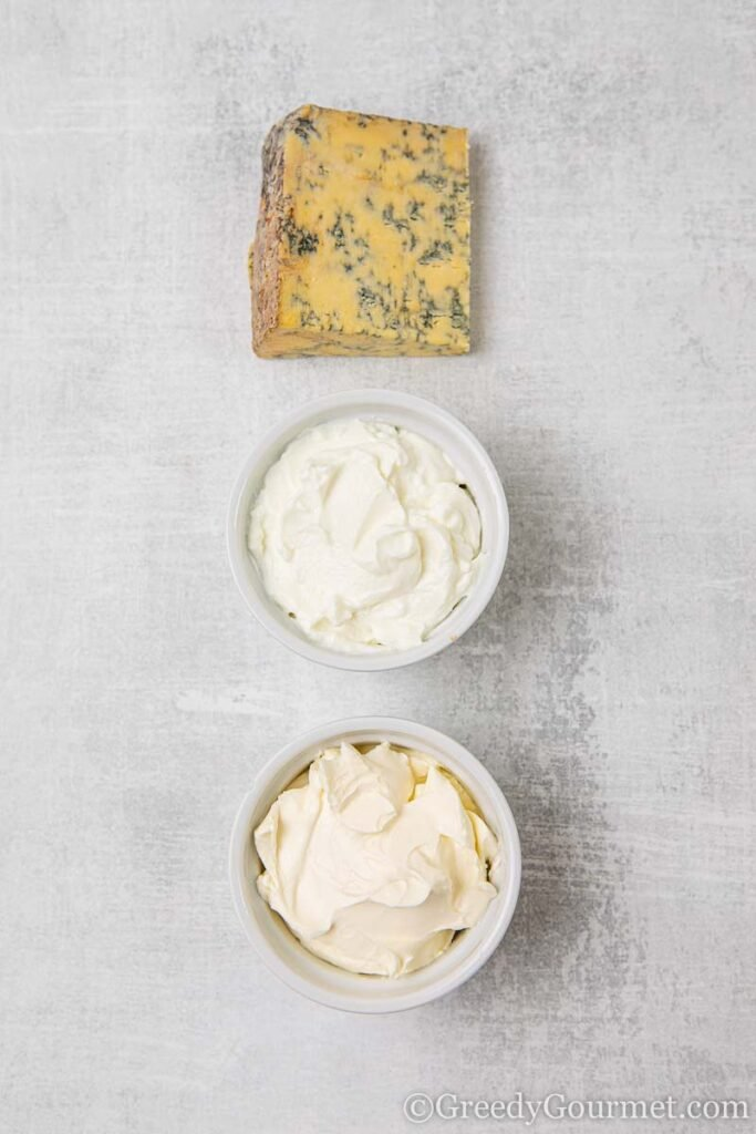 Chunk of blue cheese and ingredients to make a creamy dip