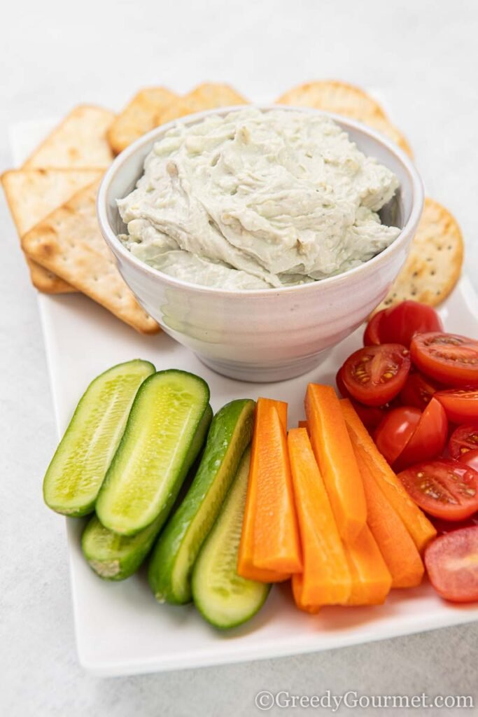 Bowl of blue cheese dip and fresh cut vegetables