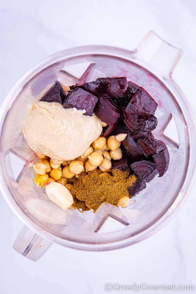 Ingredients for a vegan beet recipe in a blender