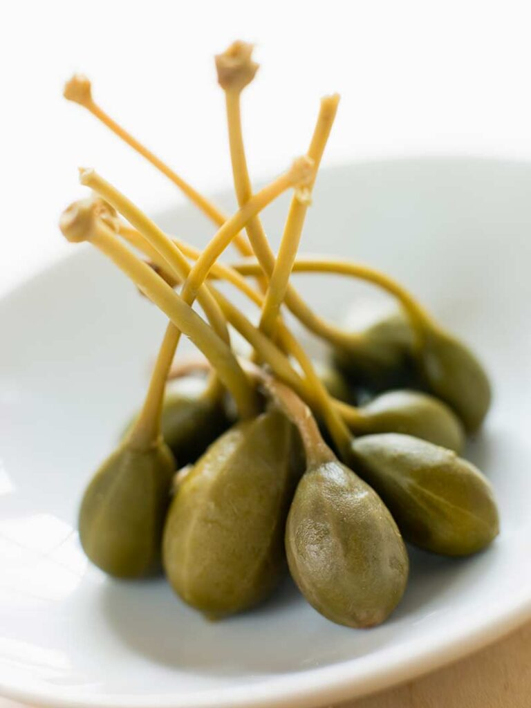 Green capers berries with stems