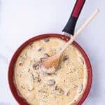 Creamy sauce in a pan to learn how to make creamy mushroom sauce