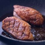 Up close pan seared duck breasts
