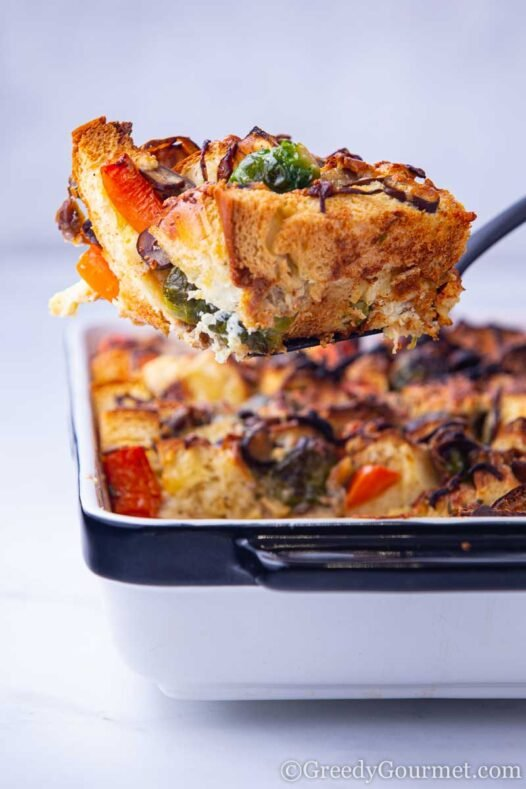 Colorful slice of savory bread pudding