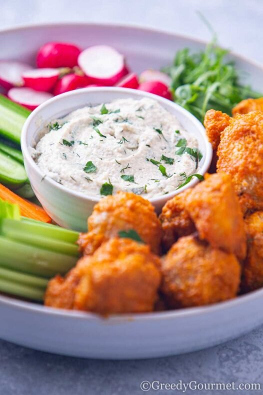 Bowl of cashew ranch recipe and hot wings